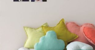 A comfy little day bed like this is a great idea for a kids room or playroom!